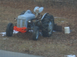 It's a fuzzy picture because I took it through a screen.   You think I'm going out in the  cold to take a picture of a tractor?