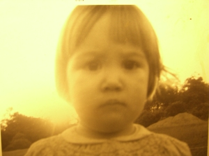My little sister in 1969.  I was too trapped in the stare-down to get a picture of the grandbabe.