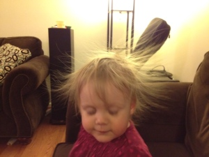 She wasn't swishing her hair.  It was sticking straight out after an encounter with the sofa.